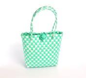 Grüne Webarttasche auf weißem Hintergrund stockbild
