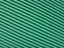 Grüne Wellpappe stockbilder