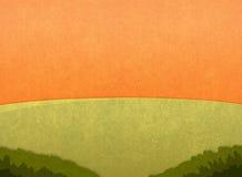 Grüne Wiese bei Sonnenuntergang Stockbilder