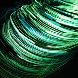 Grüne wirbelnde Zeilen Lizenzfreies Stockfoto