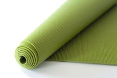 Grüne Yoga-Matte Stockfotos