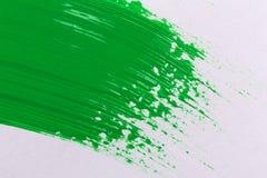Grüner Anschlag des Lackpinsels Stockbild