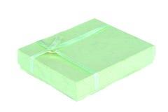 Grüner anwesender Kasten getrennt Stockbild
