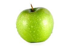 Grüner Apfel auf einem weißen Hintergrund lizenzfreie stockfotografie