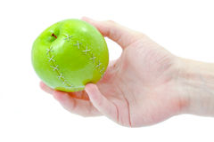 Grüner Apfel in der Hand Lizenzfreies Stockbild
