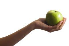 Grüner Apfel in der Hand Lizenzfreie Stockfotografie