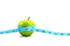 Grüner Apfel mit Band Lizenzfreie Stockbilder