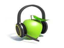 Grüner Apfel mit Blatt auf Kopfhörern Lizenzfreie Stockbilder