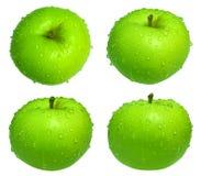 Grüner Apfel mit Tropfen Stockfotos