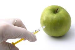 Grüner Apfel spritzte ein Lizenzfreie Stockfotografie