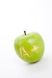 Grüner Apfel und ein Pluszeichen Stockbild