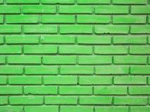 Grüner Backsteinmauerbeschaffenheitshintergrund Stockfotos