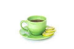 Grüner Becher mit Zitrone Stockfoto