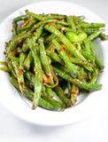 Grüner Bohnenchineseteller Stockfotos
