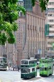 Grüner Bus auf Hong- Kongstraße Stockbild