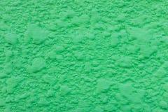 Grüner dekorativer Gips auf der Wand Kunst gren Hintergrund Stockbild
