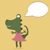 Grüner Drache in einem rosa Kleid, das lernt zu tanzen Stockfoto