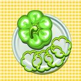 Grüner Gemüsepaprika auf einer Platte mit Scheiben Stockfotos