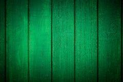 Grüner hölzerner Hintergrund Vignetted Stockbild