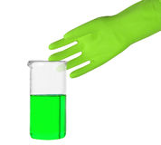 Grüner Handschuh und ein Reagenzglas Lizenzfreie Stockfotografie