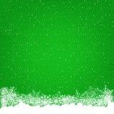 Grüner Hintergrund der Weihnachtsschneefälle Stockbild