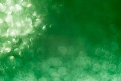 Grüner Hintergrund des Zusammenfassungsfunkelns für Karte und Einladung stockbilder