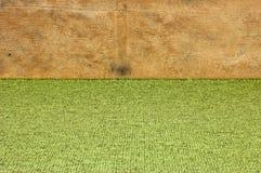 Grüner Hintergrund mit hölzerner Ordnung Lizenzfreies Stockfoto