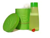 Grüner Kasten mit Rohbaumwolle und grüne Kapazität mit Lizenzfreie Stockfotos