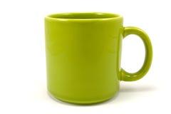 grüner keramischer Teacup Stockfotos