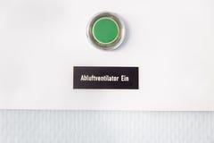 Grüner Knopf mit deutschen Wörtern Lizenzfreies Stockbild