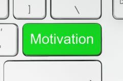 Grüner Knopf mit Motivationswort auf der Tastatur Stockfotografie