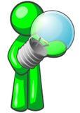 Grüner Mann mit Glühlampe Lizenzfreie Stockfotografie