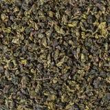 Grüner oolong Teehintergrund Stockbild