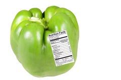 Grüner Pfeffer mit Nahrung-Kennsatz Lizenzfreies Stockfoto
