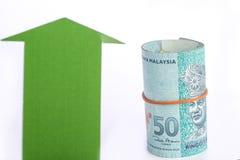 Grüner Pfeil mit Geld Lizenzfreies Stockfoto