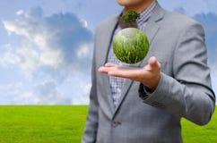 Grüner Planet auf der Hand Stockfotos