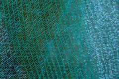 Grüner Plastiknetzbeschaffenheitshintergrund Lizenzfreie Stockfotografie