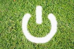 Grüner Rasenlogo-Netzschalter an weg Lizenzfreie Stockbilder