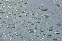Grüner Regen lässt abstrakten Hintergrund fallen Lizenzfreies Stockfoto