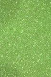 Grüner schimmernder Hintergrund mit funkelnden Lichtern und reflectio Stockfotografie