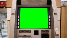 Grüner Schirm für Ihre Anzeige an ATM-Maschine Lizenzfreie Stockfotos