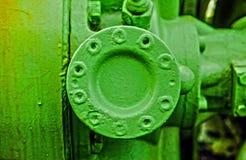 Grüner Schmutzmetallbau Stockfotos