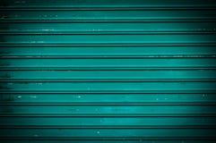 Grüner Schmutzmetallwandhintergrund Stockbilder