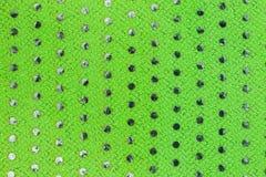 Grüner Stoff mit Plastikkreisen Lizenzfreie Stockfotografie