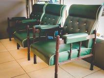 Grüner Stuhl der Weinlese Stockbilder