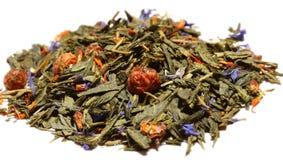Grüner Tee mit Blumen stockbild