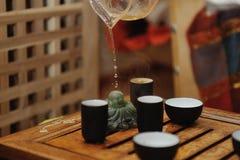Grüner Tee mit Cup und Teekanne Lizenzfreie Stockfotos