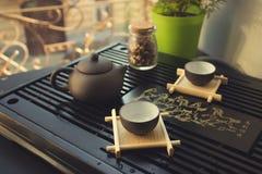 Grüner Tee mit Cup und Teekanne Lizenzfreie Stockbilder