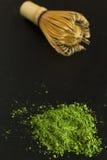 Grüner Tee und wischen Stockfoto