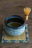 Grüner Tee und wischen Stockbild